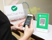 A Chinese tourist paying with WeChat Pay - China Elite Focusjpg